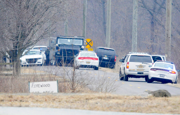 Don Knight   The Herald Bulletin<br /> Sheriff's deputies, a SWAT team, two K-9 units, a drone, Indiana State Police and FBI agents respond to the scene of a hostage situation in the 4400 block of South County Road 100 East on Saturday.
