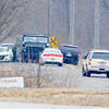 Don Knight | The Herald Bulletin<br /> Sheriff's deputies, a SWAT team, two K-9 units, a drone, Indiana State Police and FBI agents respond to the scene of a hostage situation in the 4400 block of South County Road 100 East on Saturday.