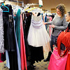 Don Knight | The Herald Bulletin<br /> Autumn Dalton helps Kylee Garrison pick out dresses to try on during Anderson Public Library's Project Fairy Godmother prom dress giveaway  on Saturday.