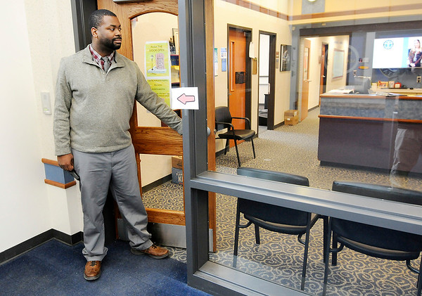 Don Knight | The Herald Bulletin<br /> Anderson Elementary School Dean Courtlon Peters stands at the new secure entrance leading into the office. The secure entrance was paid for with funds from the referendum pasted by voters.