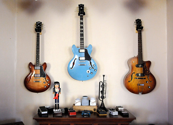 Don Knight | The Herald Bulletin<br /> A trio of guitars hang on the wall at Zach Day's music school in Chesterfield.
