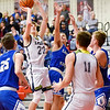 Richard Sitler | For The Herald Bulletin<br /> Kaden McCollough attempts a shot for Shenandoah in the paint during the first half of 2A sectional action at Knightstown on Friday.