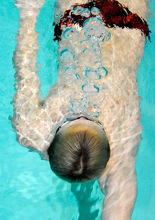 Don Knight | The Herald Bulletin<br /> Dayton Edwards practices his backstroke in the Anderson pool.