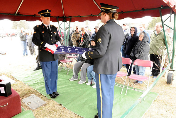Don Knight   The Herald Bulletin<br /> From left, Spc. Brandon Hazelbaker and Sgt. Megan Mason fold the flag for WWII veteran 1st Lt. Shirley W. Warfield on Thursday at Anderson Memorial Park Cemetery.
