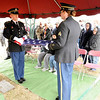 Don Knight | The Herald Bulletin<br /> From left, Spc. Brandon Hazelbaker and Sgt. Megan Mason fold the flag for WWII veteran 1st Lt. Shirley W. Warfield on Thursday at Anderson Memorial Park Cemetery.