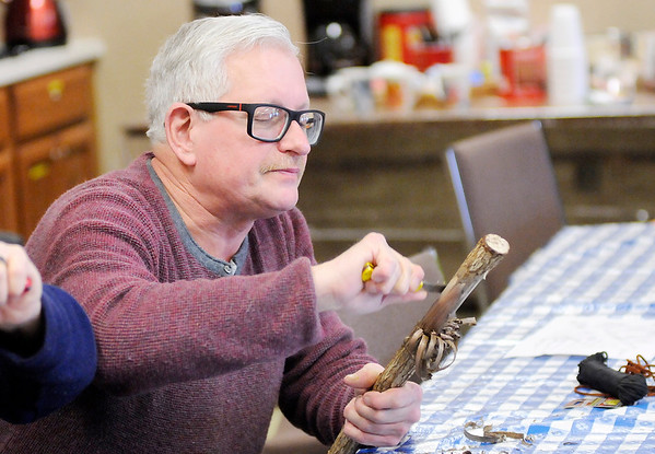 Don Knight   The Herald Bulletin<br /> Jimmie Griner removes the bark from his walking stick during a workshop at Mounds State Park on Saturday.