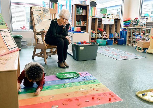 John P. Cleary | The Herald Bulletin <br /> How You Can Help. Volunteer Kathy Freer works with the younger children at Alternatives Inc.