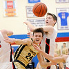 Don Knight | The Herald Bulletin<br /> The ball is knocked loose on a drive by Lapel's Reid Ratzlaff as the Bulldogs faced Wapahani in the sectional semi-final at Elwood on Friday.