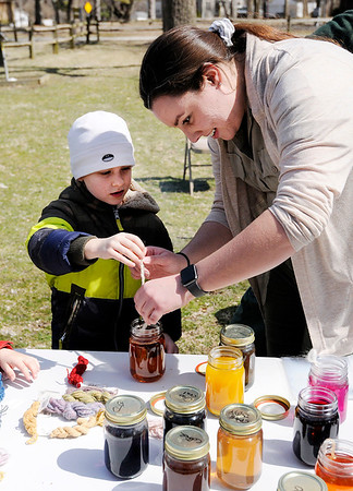 """Don Knight   The Herald Bulletin<br /> Seasonal naturalist Miranda Wentz helps Charlie Eckert, 6, dye the yarn he spun during Mounds State Park's """"Spin until you Dye"""" event on Wednesday."""