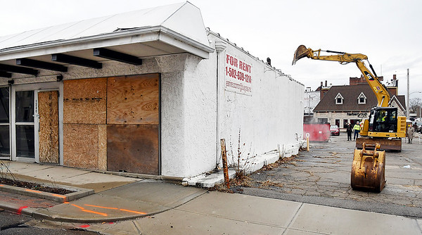 John P. Cleary | The Herald Bulletin <br /> Work started Wednesday on the demolition of the old building on the northeast corner of 13th and Jackson Streets to make way for the new CATS bus terminal to be built on the site.