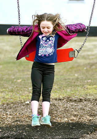 John P. Cleary | The Herald Bulletin Jentry Mahoney, 6, takes a leap out of the swing as she plays at the Falls Park playground in Pendleton Monday afternoon. Jentry is from Bowling Green, Missouri and is here visiting family while on spring break.