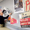 John P. Cleary | The Herald Bulletin<br /> Chris DeHart, a social studies teacher at Pendleton Juvenile Correctional Facility, decorates his classroom walls with materials used in his teaching.