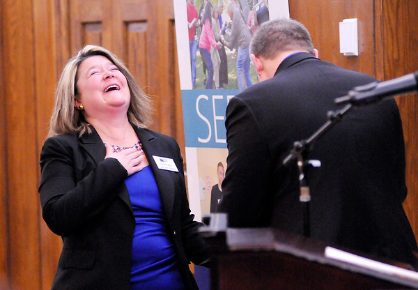 Don Knight   The Herald Bulletin<br /> Leadership Academy of Madison County Executive Director Carrie Bale laughs as David Dodd surprised her with a diploma during the Leadership Academy's graduation at The Anderson Country Club on Thursday.