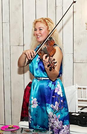 Wedding and event violinist-virtuoso Olga Berezhnaya serenades the visitors to the Crystal Coop Bridal Expo. (Mark Maynard photo).