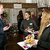 Steve Johnson, of Synthessis Entertainment, discusses his company's services with bride-to-be Jordan Metcalfe and her friend, Angie Balfour, at the Crystal Coop's Bridal Expo. (Mark Maynard photo)
