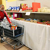 Don Knight | The Herald Bulletin<br /> Terry Carter Sr. adds a box of cereal to his cart while visiting the food bank at Operation Love on Wednesday.