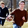 John P. Cleary | The Herald Bulletin<br /> Zach Smith, right, takes off with the football after intercepting a pass as Jake Jordan tries to run him down as they played touch football in front of Dunn Hall on the Anderson University campus Monday afternoon. The AU sophomores were enjoying the sunshine and warmer temperatures that covered the area.