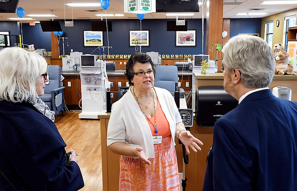 John P. Cleary   The Herald Bulletin<br /> Debra Hunt, center, PCT certified, of U.S. Renal Care, explains the facilities to Carlene Westerfield-Gunter and Dirk Webb of the Madison County Chamber during the open house Thursday for the new Anderson dialysis clinic at 2220 East 59th Street.
