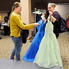 Don Knight | The Herald Bulletin<br /> McKenzie Shoaf decides between two dresses held up by Stephanie O'Sullivan during Anderson Public Library's Project Fairy Godmother prom dress giveaway  on Saturday.