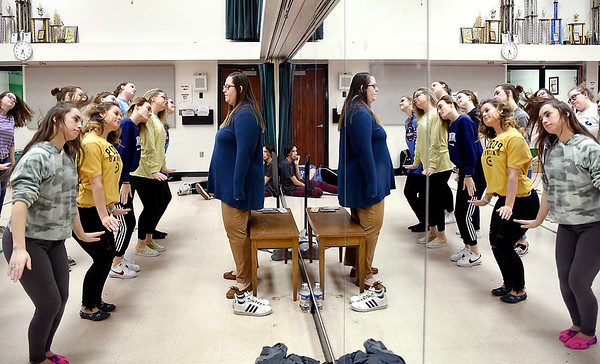 As Pendleton Heights Choral Director Erin Strouse watches, show choir members go through their dance moves as they rehearse for their appearance at the 2020 FAME Show Choir National Finals at Branson, Missouri.