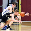 Daleville's Cayden Gothrup looses the handle on the ball as APA's Mason Watson goes after the ball.