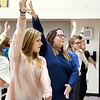 Pendleton Heights Choral Director Erin Strouse, center, demonstrates how the arms should be on this dance move as the show choirs practice for the upcoming 2020 FAME Show Choir National Finals at Branson, Missouri.