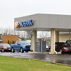 Customers were lined up for the drive through at the PNC Bank at the Mounds Mall on Friday. The lobby was closed as part of efforts to stem the spread of COVID-19.