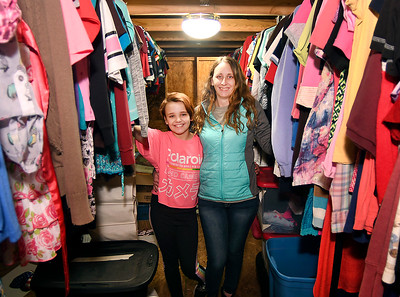 Jennifer Hicks with her daughter Maci Dowden, 10, who inspired the idea of a clothes closet, stand in the middle of The Clothes Garden in the attic of their Frankton home.