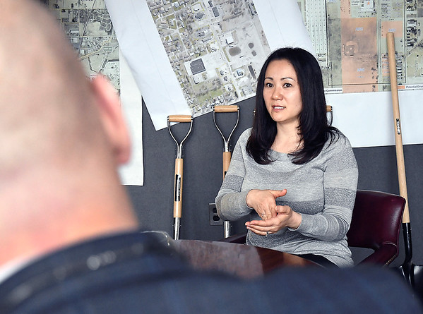Specialist Ayako Girt and Greg Winkler discuss items during a meeting in the Anderson Economic Development Department recently.