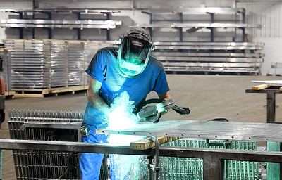 Welder Lee Mohler works on a section of grating being manufactured at the former Pay Less building at 2310 Broadway in Anderson.