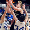 Daleville's Connor Fleming goes up to shoot as APA's Hayden Hornocker and Kuron Nickson try to get a hand on the ball.