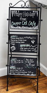 the menu board of the Dapper Cat Cafe located in the lobby of the Union Building in downtown Anderson.