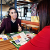 Krystal Ardayfio, workforce development consultant for Ivy Tech's Anderson campus, discusses with Jammie Barker, general manager of the McDonald's at 53rd and Scatterfield Road, the co-branding program between the two to help McDonald's employees earn scholarship money for school.