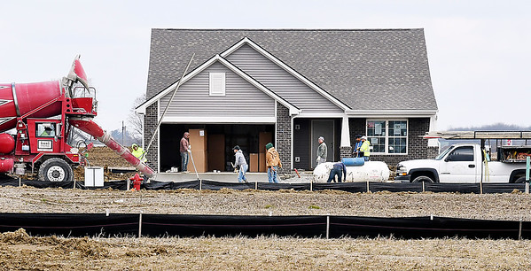 The driveway is being poured for this new house in the Maple Trails housing addition on CR 650 West.