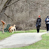 These folks were keeping their social distancing as they walked their dogs along the trails through Falls Park Monday afternoon.