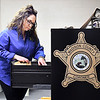 Madison County Coroner Danielle Noone goes through files in  her office located in the basement of the Health Department at 9th & Central Avenue.