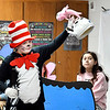 The Cat in the Hat, Indiana Christian Academy fifth-grader Noah Jones, grabs the fish from his bowl as he plays havoc in the special presentation of the story by Erica Reasoner's Indiana Christian Academy 5th grade class Monday.