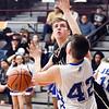 Daleville's Connor Fleming eyes the basket as he splits APA defenders driving the baseline to get a shot over Hayden Hornocker.