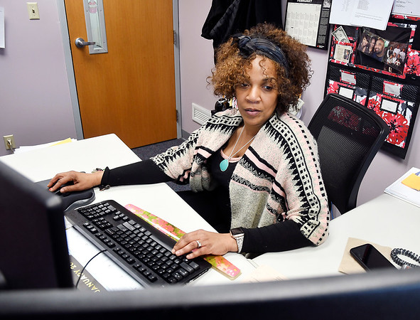 Probation officer Nichelle Serf works in her office inside the Madison County Youth Center.