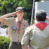 Boy Scout Troop 301 senior patrol leader Quinton Bell, 14, salutes as the colors are raised during the Memorial Day ceremony at Maplewood Cemetery.