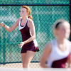 Alexandria's Allie Houeston returns a volley as she and Abbie Miller face Lapel's Katie Boldman and Sara St. Clair at No. 1 doubles during the tennis sectional championship at Highland on Friday.