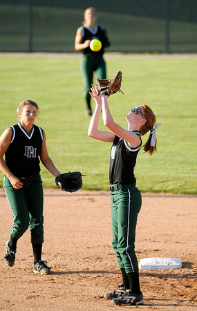Sarah Dixon catches a fly ball at second base as Pendleton Heights faced Roncalli in regional softball action on Tuesday.