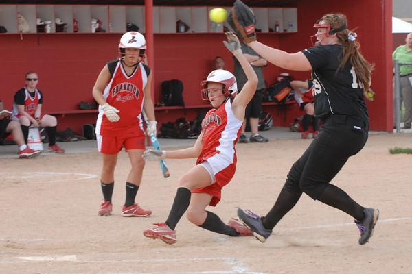 Frankton Eagle Liz Armendariz slides safely across home plate on a passed ball.