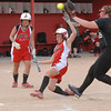 Frankton Eagle Liz Armendariz slides safely across home plate on a passed ball.