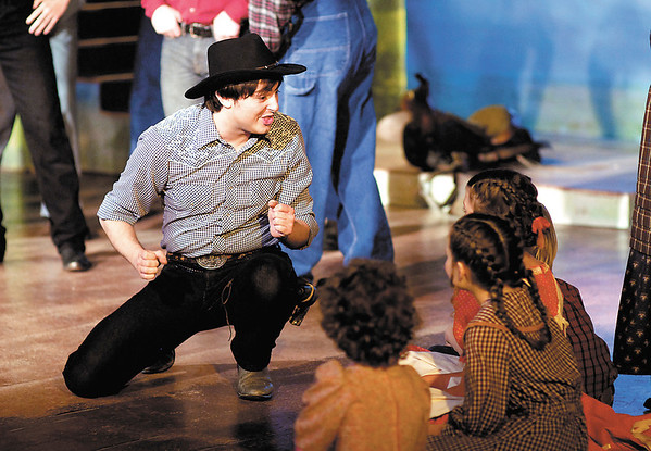"""Zachary Ryan Allen as Will Parker sings to a group of children in """"Oklahoma!"""" The production runs this weekend and next at Anderson's Mainstage Theatre, 124 W. Ninth Street."""