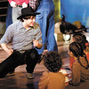 "Zachary Ryan Allen as Will Parker sings to a group of children in ""Oklahoma!"" The production runs this weekend and next at Anderson's Mainstage Theatre, 124 W. Ninth Street."