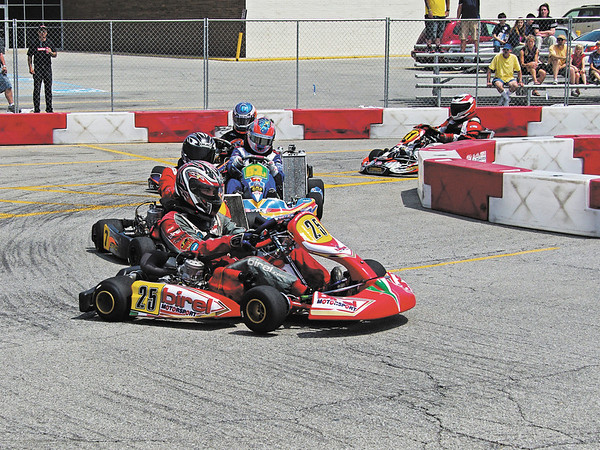 Alex Conlin leads the field through turn one at the start of the Shifter Kart final.