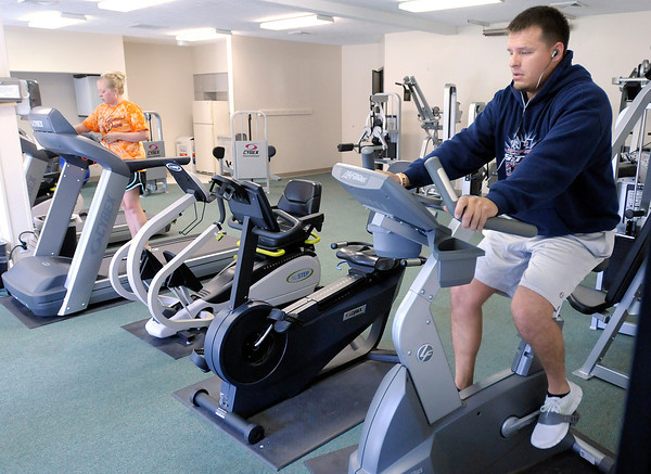 From left, Nocole Chambers and Justin Atwood work out in the new Red Gold Fitness Center at the Elwood YMCA on Tuesday. The YMCA held an open house on Tuesday to show the public their renovated facilities and new equipment.