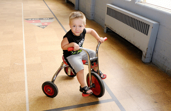 Braylon Boone, 3, rides a tricycle in the gym at the Gateway Association inside First United Methodist Church on Tuesday.