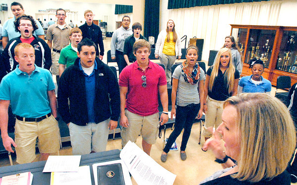 AHS choir director Julie Wood works with her students as they rehearse for their appearance with Foreigner this Saturday at Hoosier Park.